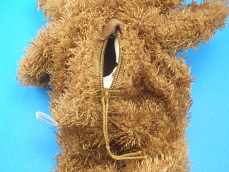 Rear of the unstuffed bear.  Insert the stuffing through the zipper opening.